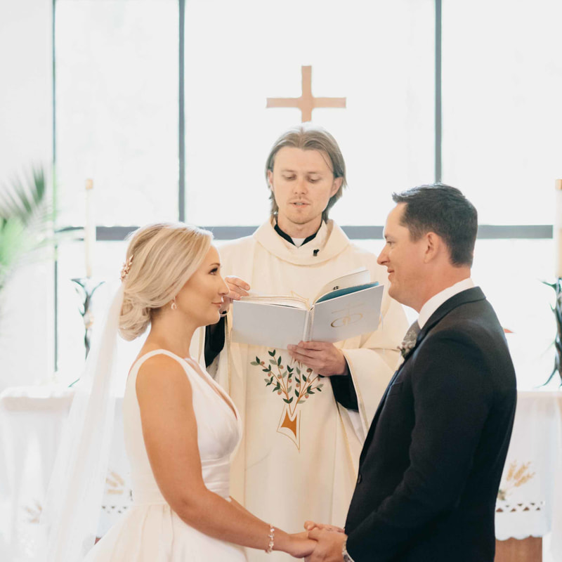 beaver creek chapel ceremony, real weddings, colorado mountain weddings, catholic ceremony, bride and groom holding hands, mountain wedding inspiration, sweetly paired wedding planning