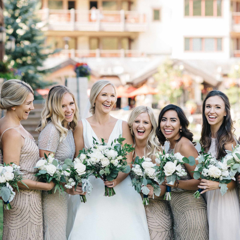 bridal party, bride and bridesmaids laughing, beaver creek village, park hyatt beaver creek weddings, colorado real weddings, mountain wedding planner, vail wedding planner