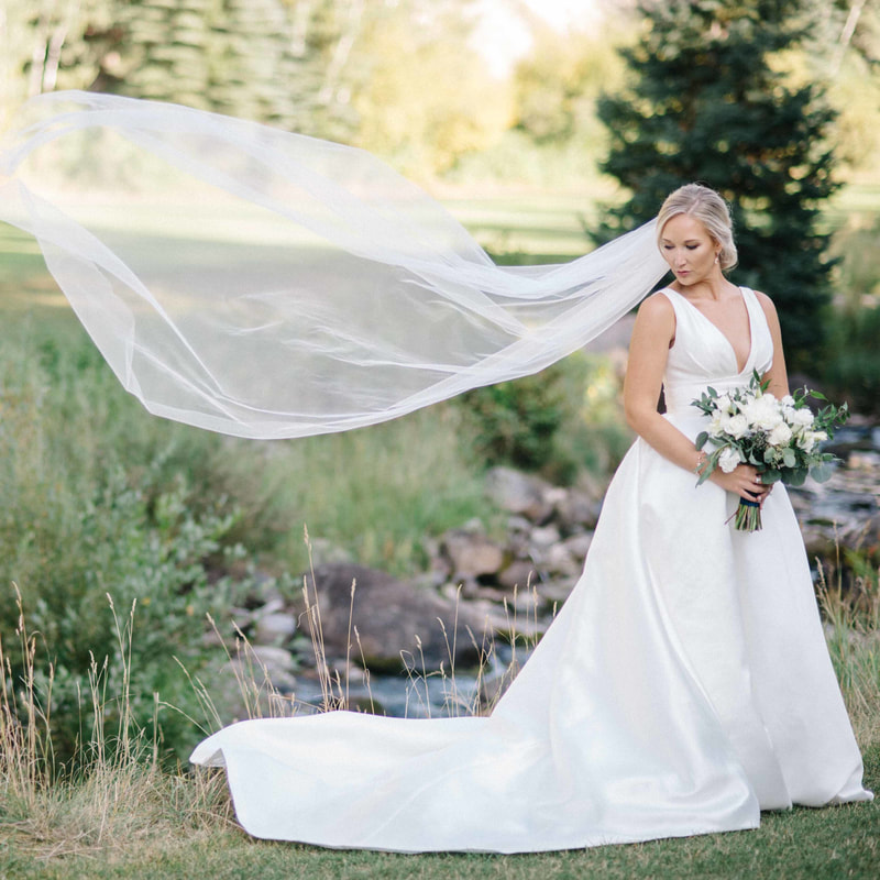 bridal veil blowing in the wind, mountain wedding planning, beaver creek chapel wedding, bridal portraits, vail wedding planner, mountain wedding inspiration