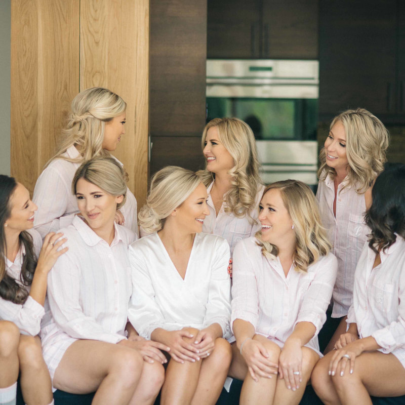 bridal party getting ready photos, bride and bridesmaids in matching white button down shirts and socks, colorado mountain weddings, beaver creek wedding inspiration