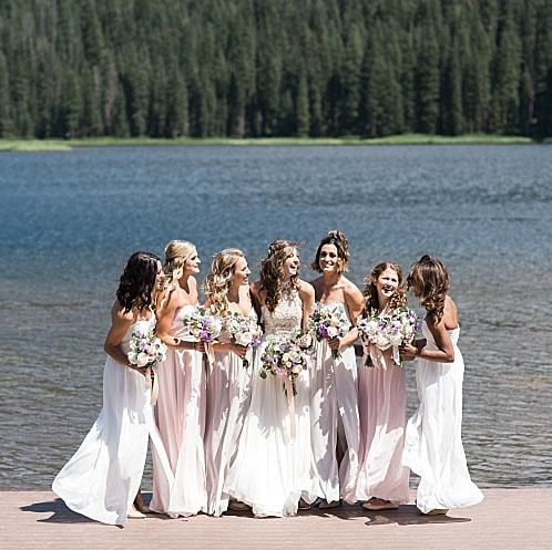piney river ranch wedding planner, mountain lakeside wedding, mountain wedding inspiration, bride and bridesmaids portrait, laughing in front of mountain lake
