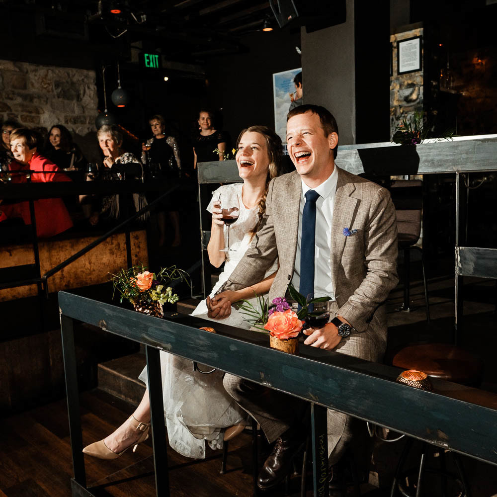 toasts, couple laughing, Ophelia's Electric Soapbox reception venue, live wedding band, denver wedding planner, colorado wedding inspiration, sweetly paired wedding planning, dance floor
