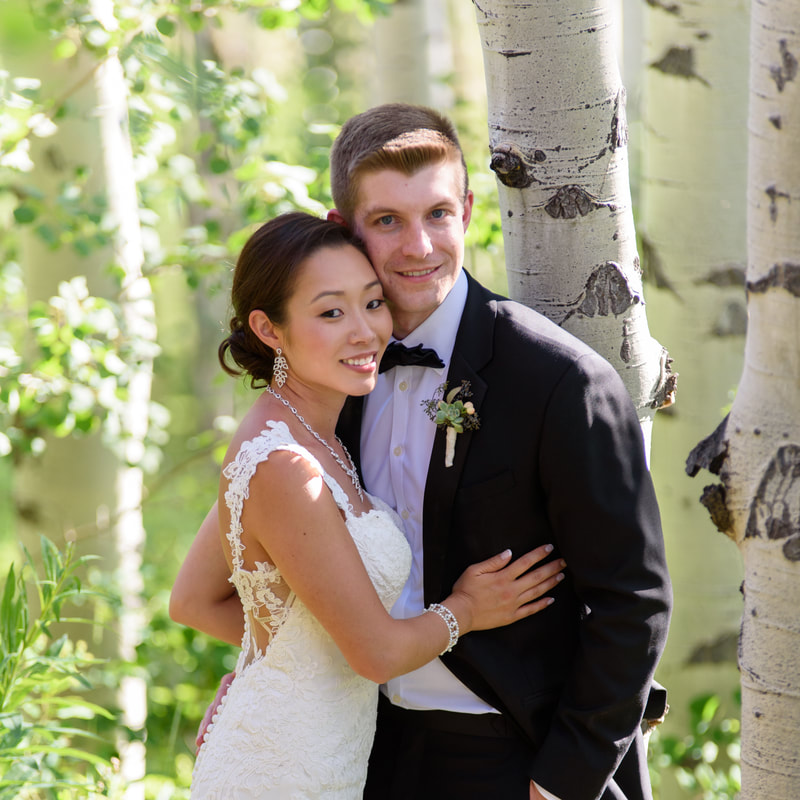 Bride and groom portrait in aspen trees, allie's cabin, mountain top wedding, beaver creek wedding planner, colorado wedding planner, sweetly paired, mixed race couple, asian bride