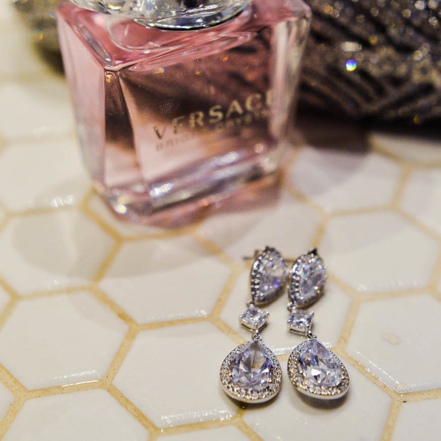 Bride getting ready photo, diamond earrings and versace perfume, detail photos, denver wedding planner, colorado wedding planner