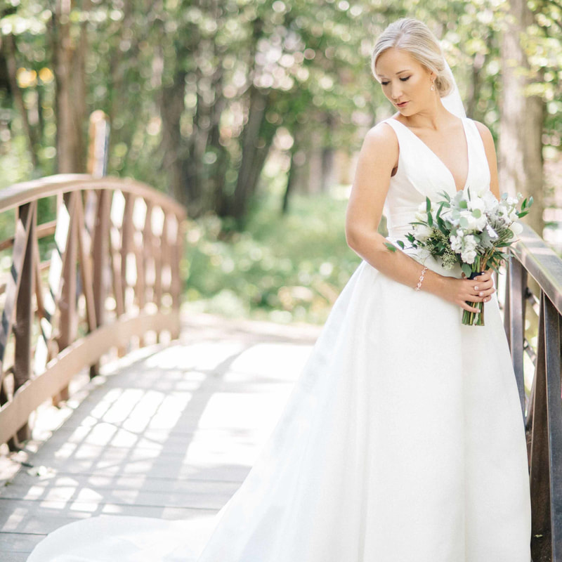 bridal portrait on bride outside beaver creek, mountain wedding inspiration, bride holding bouquet, summer wedding inspiration, sweetly paired wedding planning