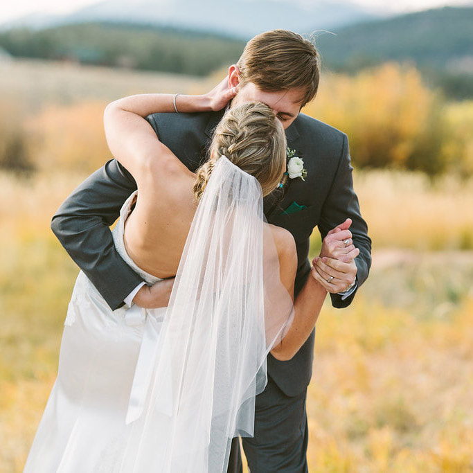 Deer creek valley ranch wedding venue, best colorado wedding planner, denver wedding planner, mountain wedding inspiration, sweetly paired weddings, first kiss, bride and groom portrait