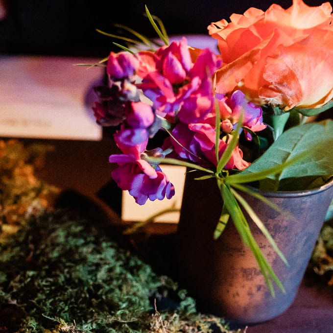 floral centerpieces with moss, Ophelias reception venue, table setting, place setting, music inspired wedding decor, colorado wedding inspiration, sweetly paired wedding planner, denver wedding planning, city wedding planners