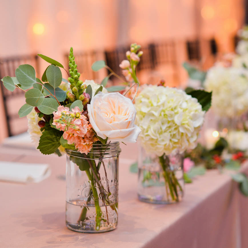 low floral Centerpieces in mason jar vases, reception detail photos at baldoria on the water, denver wedding planning, colorado wedding planner, destination wedding planner, sweetly paired