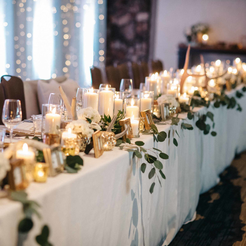 head table details, candles, antlers and greens, white linens, light wall back drop, park hyatt beaver creek ballroom wedding, mountain wedding planner, colorado wedding planner, vail wedding planning, sweetly paired