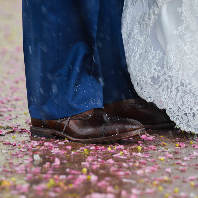 Bride and groom portrait, cherry blossoms in the snow, baldoria on the water wedding venue, denver wedding planner, colorado wedding planner, real weddings, sweetly paired, winter wedding inspiration, close up of grooms shoes, navy suit, detail photos