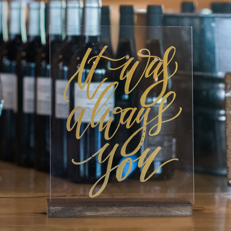 bar sign, it was always you, wine bottles, reception detail photos, piney river ranch wedding venue, reception decor, vail wedding planner, mountain wedding inspiration, sweetly paired wedding planning
