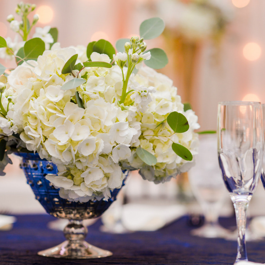 low floral Centerpieces in silver mercury glass vases, reception detail photos at baldoria on the water, denver wedding planning, colorado wedding planner, destination wedding planner, sweetly paired