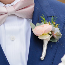 groom getting ready photo, detail photos, denver wedding planner, colorado wedding planner, navy suit with pink bow tie, boutonniere