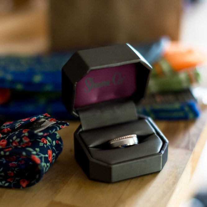 groom getting ready photo, detail photos, grooms ring in box with tie, denver wedding planner, colorado wedding planner, city wedding