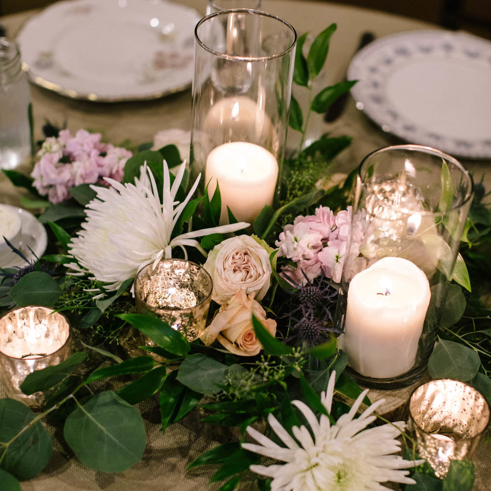 Reception decor, detail photos, place setting, mismatched china, denver wedding planner, colorado wedding inspiration, sweetly paired wedding planning, spruce mountain ranch wedding, sweetheart table, candles and floral centerpiece