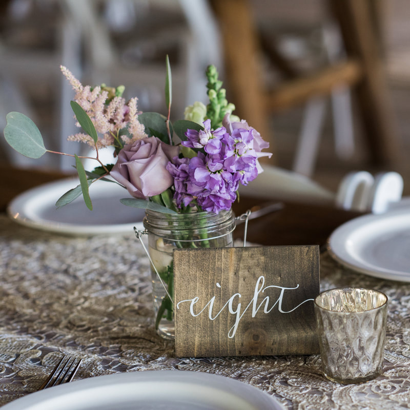 piney river ranch wedding reception, floral centerpieces, wooden table numbers, mountain wedding inspiration, vail wedding planners, beaver creek wedding planning