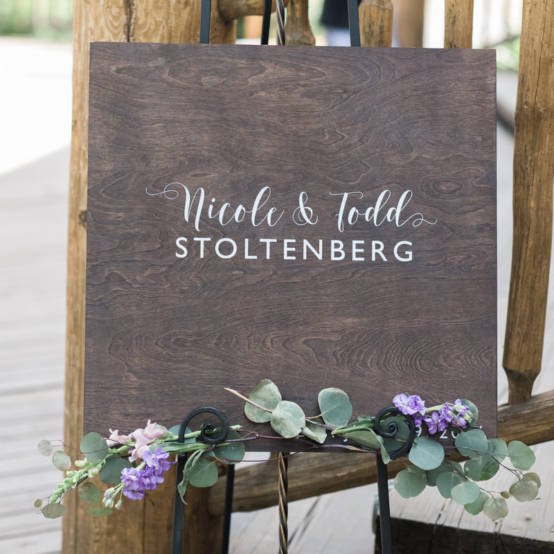 wooden welcome sign with floral sprigs, piney river ranch wedding venue, reception decor, vail wedding planner, mountain wedding inspiration, sweetly paired wedding planning