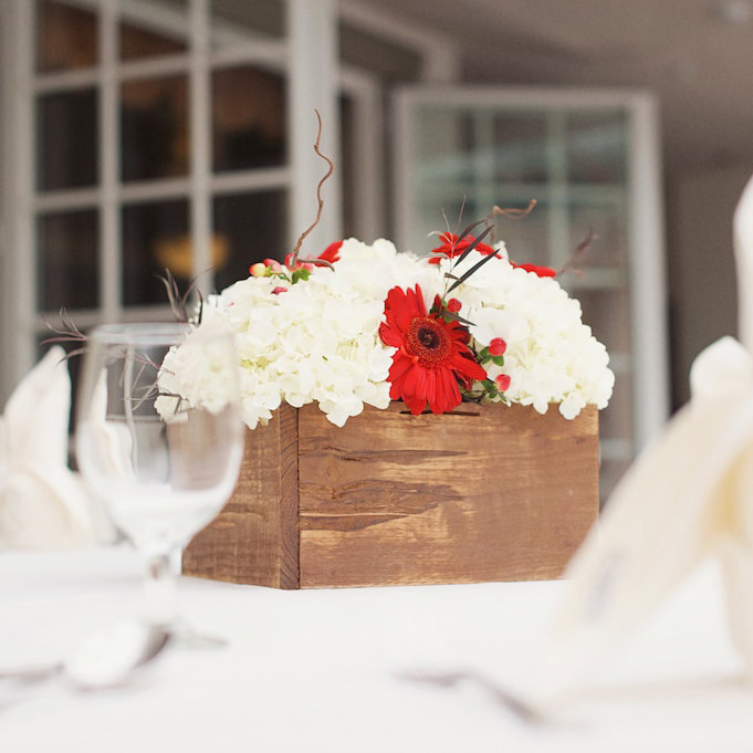 Red floral centerpieces in square wooden boxes, reception detail photos at sonnenalp, vail wedding planning, colorado wedding planner, destination wedding planner, sweetly paired weddings, mountain wedding inspiration, christmas themed wedding decor, winter weddings